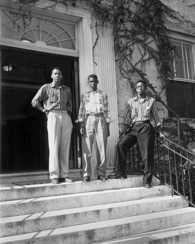 Leroy Frasier, John Lewis Brandon and Ralph Frasier stand on the steps of South Building