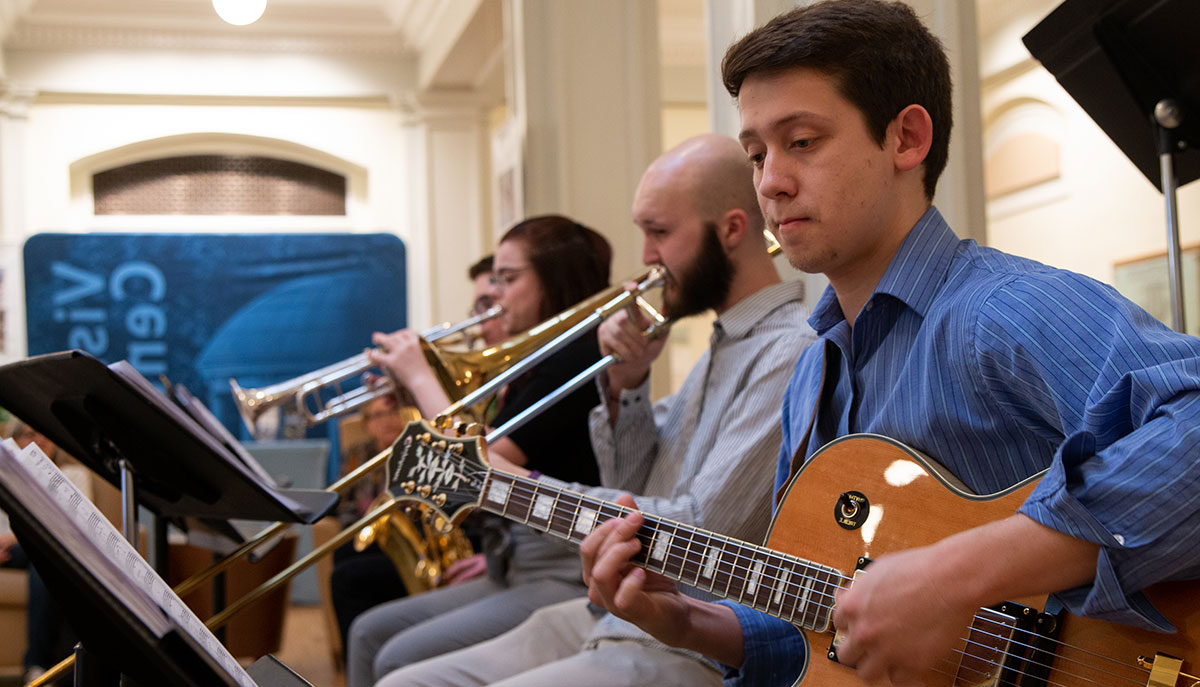 A swing band plays music in the Hill Hall rhotunda.