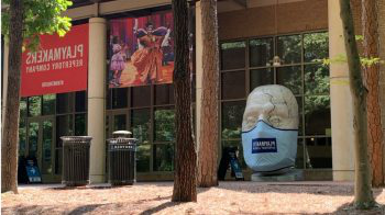 "A masked statue of Caesar from PlayMakers Repertory Company's production of ""Julius Caesar"" sits outside the Joan H. Gillings Center for Dramatic Art."